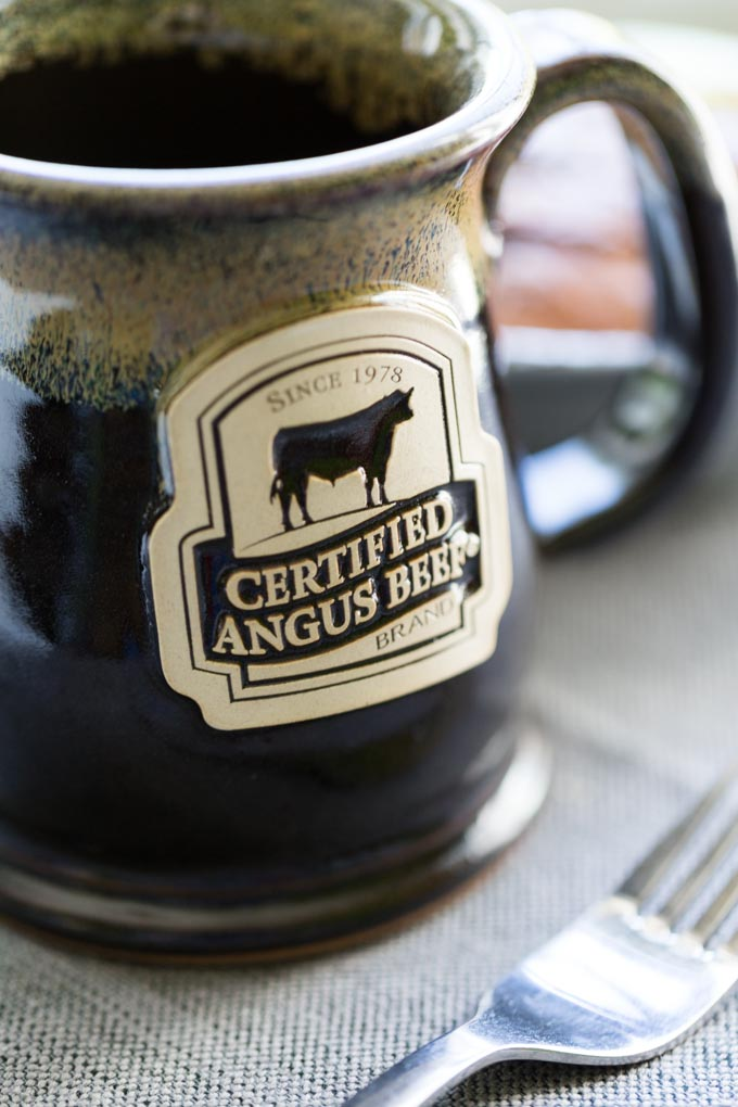 Certified Angus Beef Brand Ceramic Coffee Mug at breakfast table