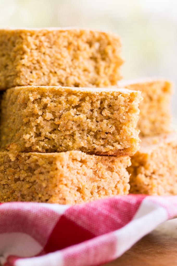 Stack of gluten free sorghum cornbread pieces on a plate