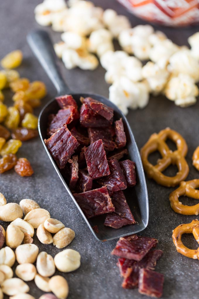 Jerky trail mix ingredients - beef jerky, pretzels, peanuts, kettle corn, golden raisins