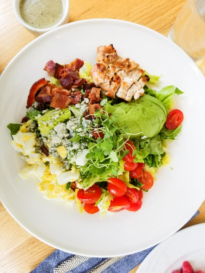 Gluten free Cobb salad on a white plate at LakeHouse restaurant