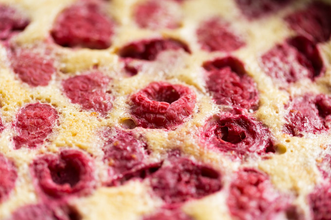 Closeup of baked raspberries in raspberry clafoutis