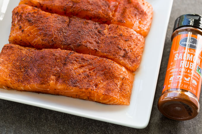 Raw salmon fillets with salmon rub