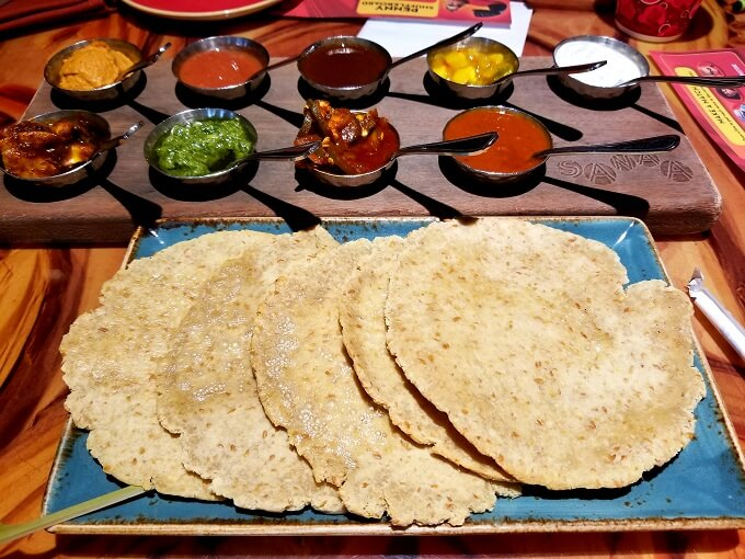 Gluten free naan bread with accompaniments at Sanaa restaurant