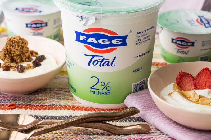 Yogurt toppings with FAGE, spoons, napkins, and bowls