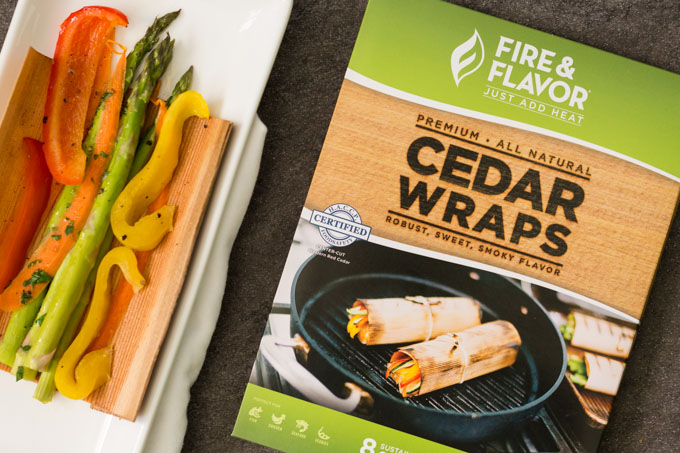 Fire and Flavor Cedar Wraps next to vegetables cooked in a cedar wrap
