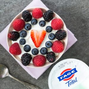 Greek yogurt bowl with berries and spoon