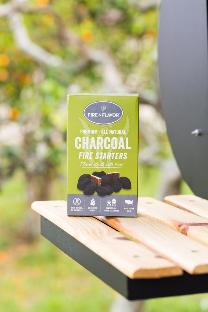 Box of charcoal fire starters next to a grill