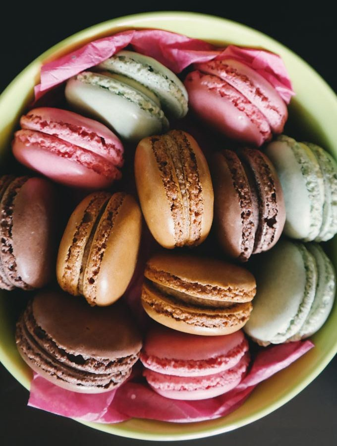 Macaron cookies in a bowl to illustrate if macarons are gluten free
