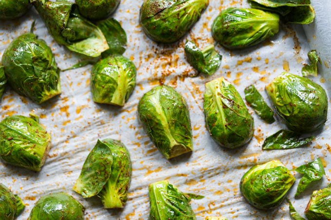 Brussels sprouts on parchment paper ready to roast