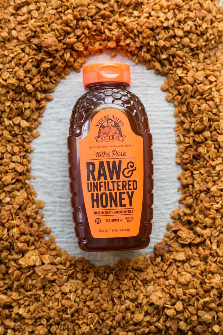 Nature Nate's raw honey surrounded by honey granola